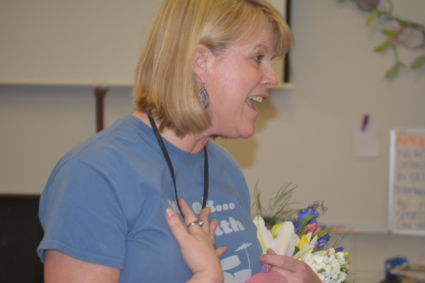Janet Levin, who has advised The Correspondent newspaper at John Hersey High School in Arlington Heights for 30 years, receives the news that she has won the IJEA's highest honor for a journalism educator: the James A Tidwell Award.