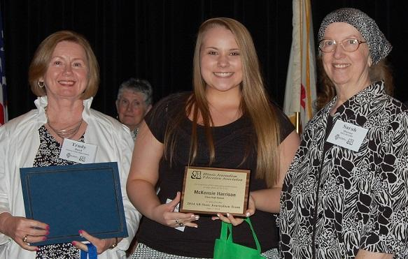 Trudy Hurd, far left, is recognized with one of her Cisne High School students who was made a member of the All-State Journalism Team, along with Sarah Doerner, IJEA president. Hurd became a Certified Journalism Educator in 2007.