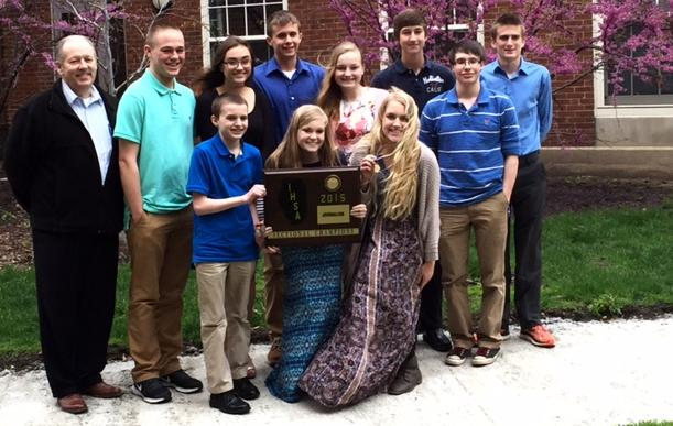 Adviser Steve Steele, left, and his Taylorville journalism students display their IHSA sectional team championship plaque after tying Urbana University High for first place at the Normal Illinois State University sectional in 2015. Students will compete at seven other sectional locations for the chance to qualify for the IHSA state final at Eastern Illinois University in Charleston for 2016.