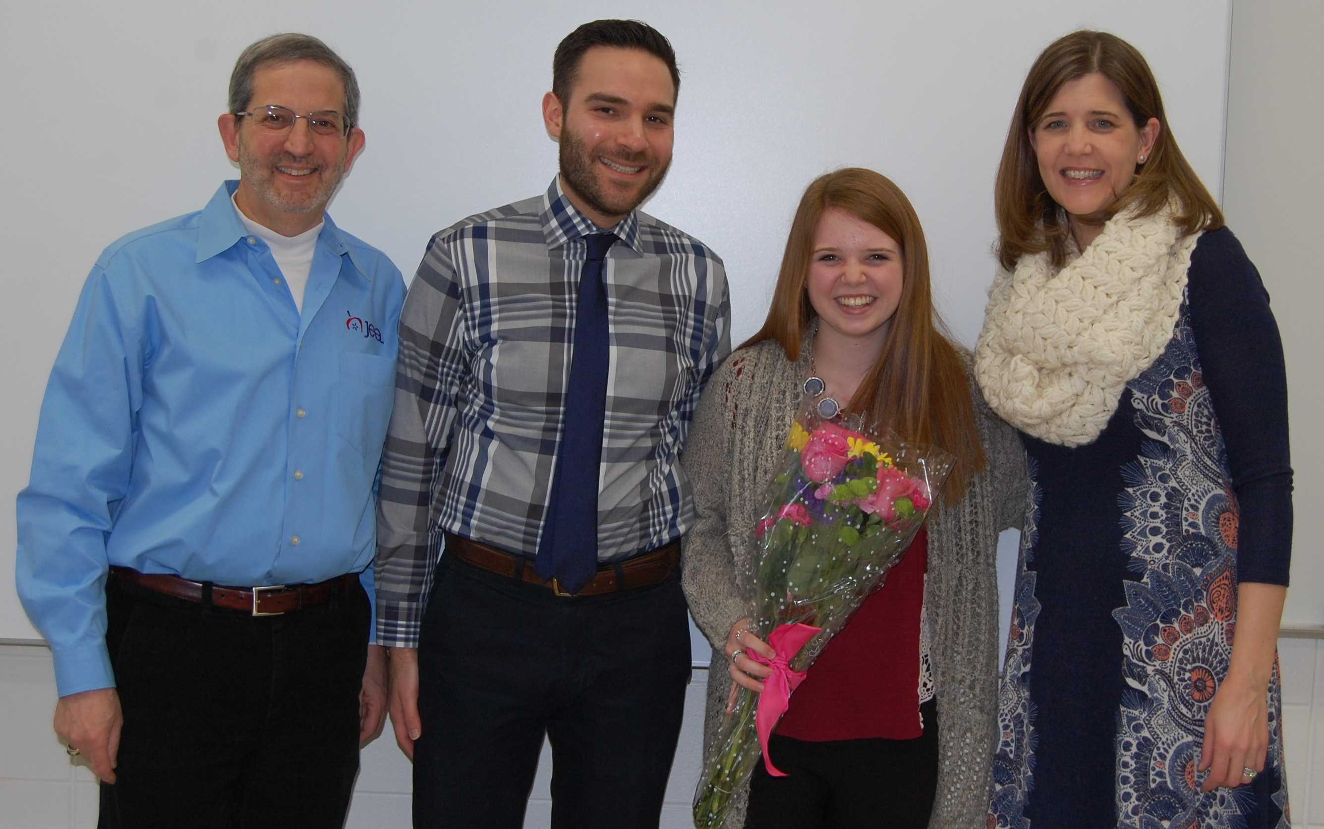 Hannah Boufford, IJEA's 2016 Illinois Journalist of the Year, is joined by (from left) Stan Zoller, East Region director of national JEA and an IJEA board member; Michael Gluskin, Libertyville H.S. Drops of Ink newsmagazine adviser; and Brenda Field, Illinois state director for national JEA and an IJEA board member. This photo was taken last March, when Stan and Brenda visited Libertyville High to inform Hannah of her award in person.