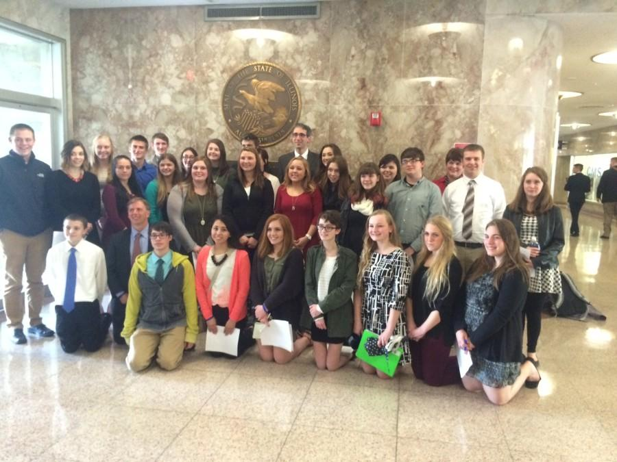 Journalism students from throughout Illinois stand with Rep. Will Guzzardi (D-Chicago) in Springfield on April 6. The bill to protect student journalists free speech rights was unanimously voted through committee that day.