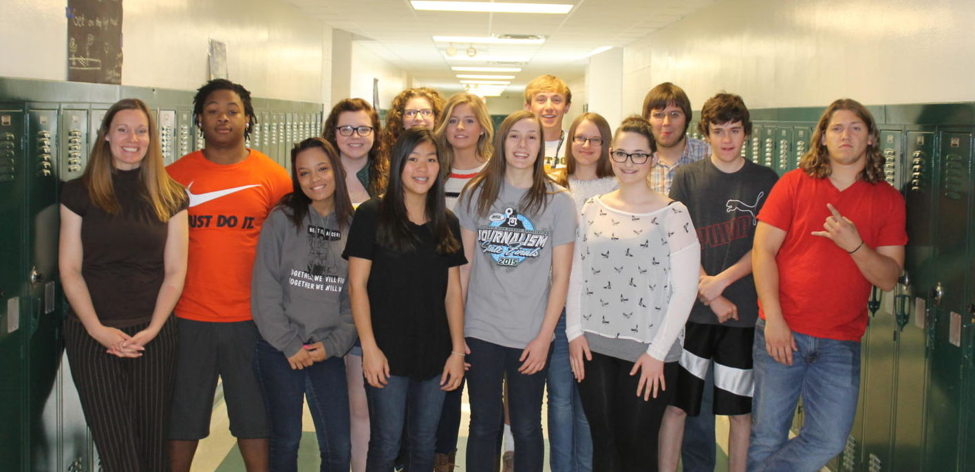 The 2015 staff of the MHS Mirror newspaper stands in the halls of Mattoon High School for our annual photo. Several would go on to major in journalism, at least for a while, and one would end up in my first college news writing classroom.