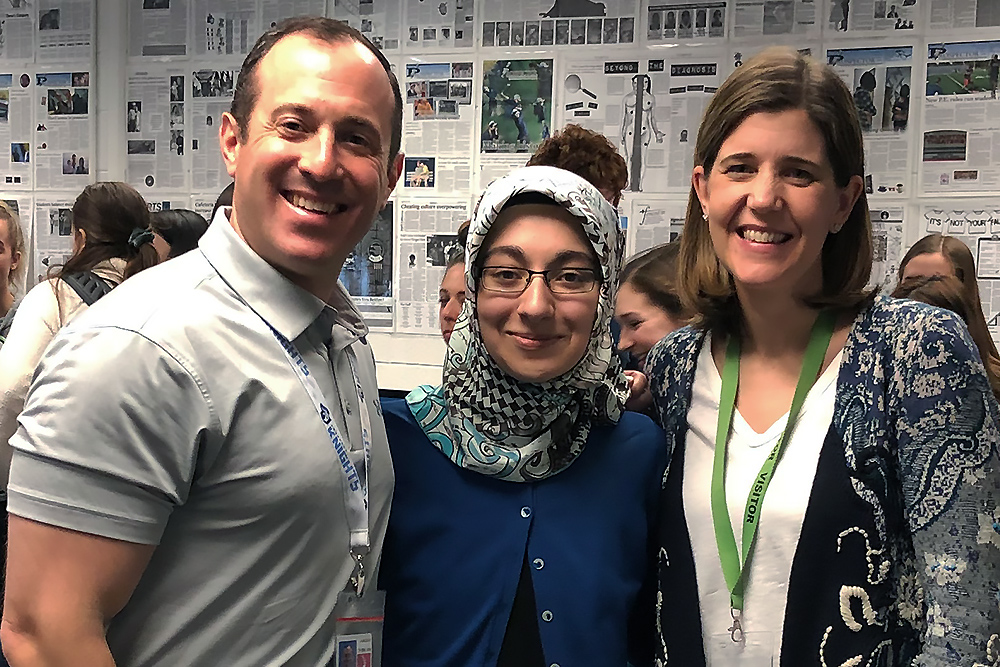 IJOY WINNER: State Director Brenda Field recently visited Prospect High School senior Ayse Eldes in her journalism classroom to deliver the good news that she had been selected as IJEA's 2019 Illinois Journalist of the Year. From left: Prospect journalism teacher and adviser Jason Block, 2019 IJOY Ayse Eldes and Brenda Field. (Photo courtesy of Jason Block)
